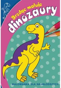 Brzdąc maluje dinozaury
