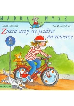 Zuzia uczy się jeździć na rowerze